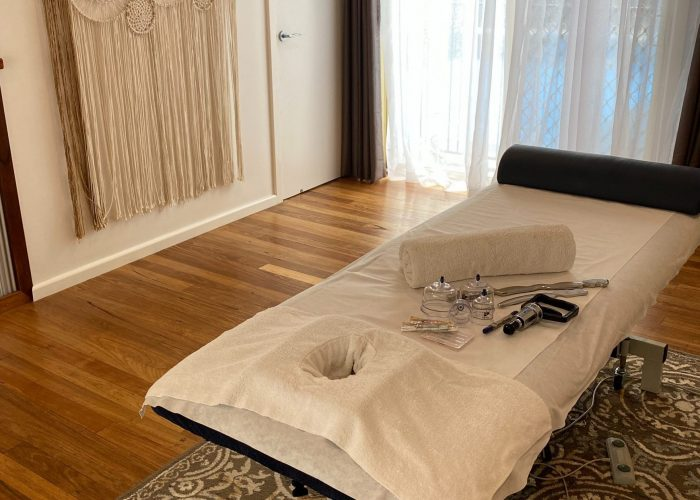 massage table with massage tools on top of it